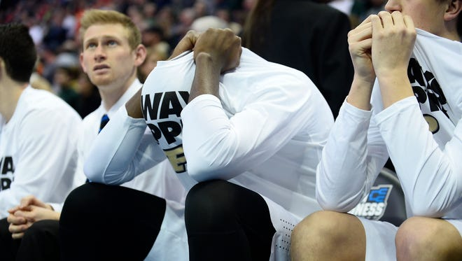 Mar 17, 2016; Denver , CO, USA; Purdue Boilermakers players can't watch in the closing seconds of the second overtime during Purdue vs Arkansas Little Rock in the first round of the 2016 NCAA Tournament at Pepsi Center. Mandatory Credit: Ron Chenoy-USA TODAY Sports