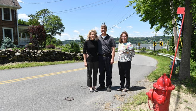 From left to right: Judy Novotny, her husband Don Rich, and neighbor Fern Sartori, stand behind a fire hydrant marking the end of a new water distribution system in Chelsea, a riverside hamlet in the Town of Wappinger. The system stops short of their homes just around the corner on River Road South, where their wells are contaminated with E.coli bacteria. The system was paid for by the New York City Department of Environmental Protection as part of an ongoing project to repair an aqueduct that brings water from the Catskills to the city.