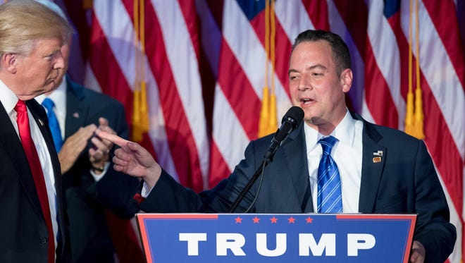 Chairman of the Republican National Committee Reince Priebus (right) gestures to Republican President-elect Donald Trump during election night at the New York Hilton Midtown in New York on Nov. 9.