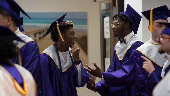 """Fort Pierce Central High School graduates Tariq Bacon (left), 17, of Fort Pierce and Darvion Blackshear, 17, of Port St. Lucie, both felt """"good"""" ahead of the school's 2018 commencement ceremony Friday.May 25, 2018, at the Havert L. Fenn Center in Fort Pierce."""