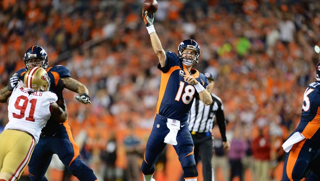 Broncos quarterback Peyton Manning throws a pass in the second quarter on Sunday night.