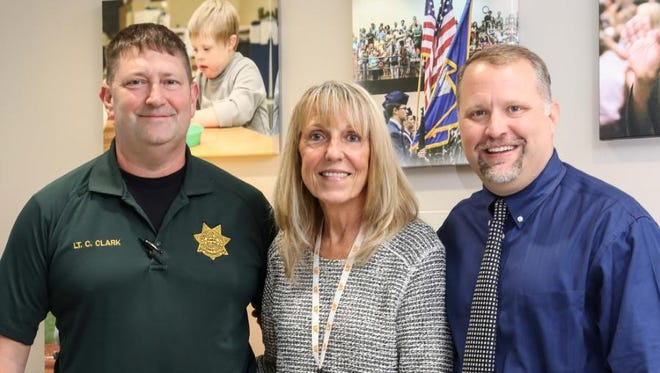 Robertson County Sheriff's Office Lt. Charlie Clark poses alongside Schools Safety Coordinator Donna Dorris and Director of Schools Chris Causey.