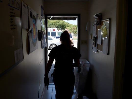 Devon Custodero, an EMT with Gold Coast Ambulance, walks out to her vehicle at the start of a shift in Oxnard. EMTs and paramedics deal with opioid overdoses at an alarming rate.