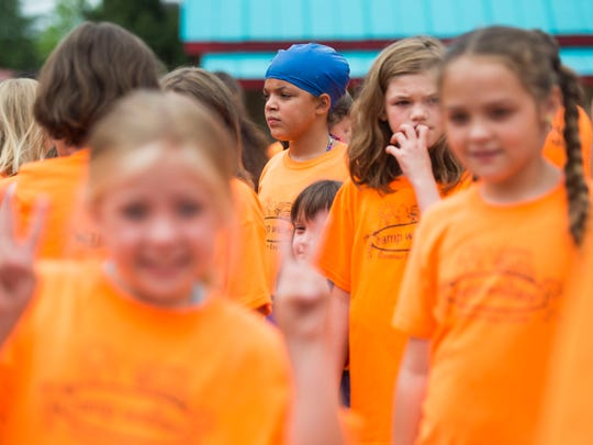 Children arrive for a giant swim lesson held by Dollywood's