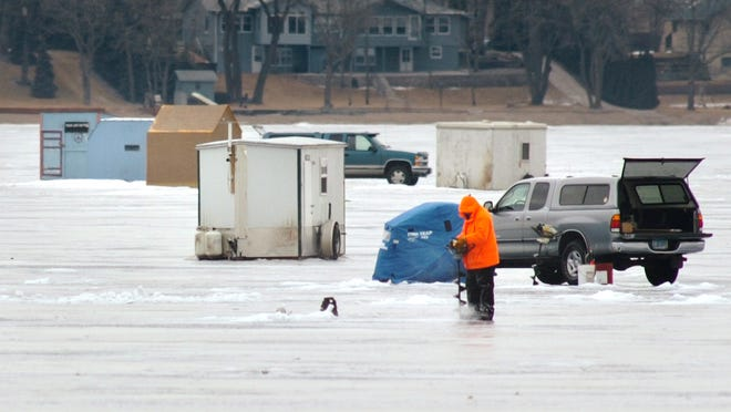 Permanent shelters like these must be removed from area lakes by the end of Monday.