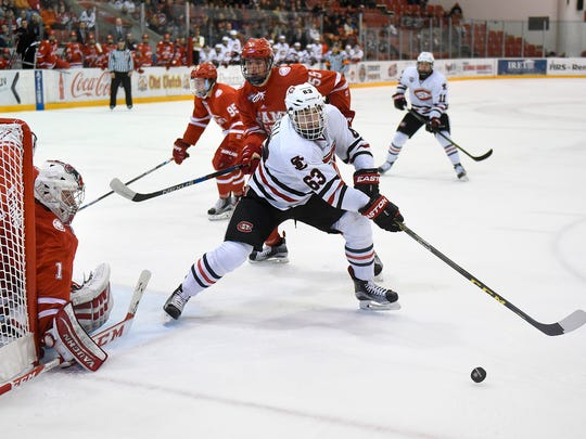 St. Cloud State's Patrick Russell (63) tries to get