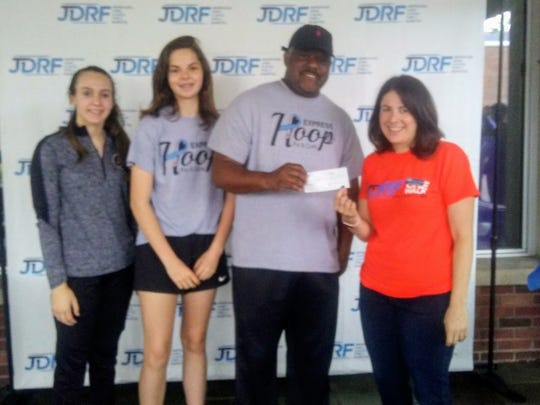 Elmira JV girls coach A'Don Allen presents a check for $500 to JDRF Executive Director Sarah Goldstein Post on May 20, 2018 during the JDRF One Walk at Elmira College. Also pictured are Elmira players Emma Cleary, left, and Megan Fedor.