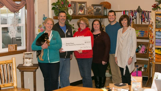 A check in the amount of $2650 was presented to Sandi Paws Rescue. Pictured left to right: Jen Steffes, Joel Gudex, Cheryl Birschbach, Corrie Wollersheim, Ryan Gueller and Mary Gueller.