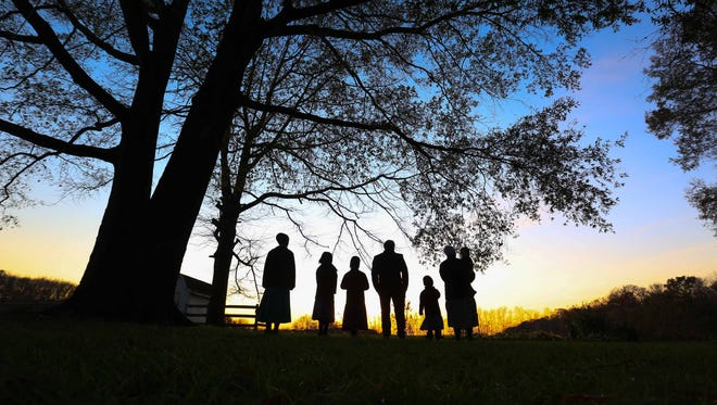 Toby and Laura Miller stand with their four daughters and son on their farm in Hartly, De. The Millers other son John David died of YARS over two years ago before doctors understood the genetic disorder that has been ending lives of young children in the Amish population.