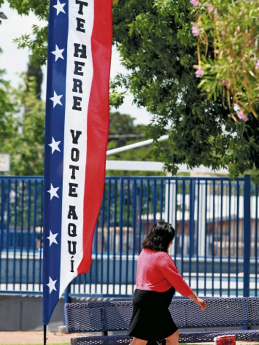 VICTOR CALZADA-EL PASO TIMES Carolina Gonzalez walked into the Carolina Recreation Center to cast her vote Monday.
