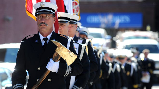 The Knoxville Fire Department Honor Guard enters a memorial service held at the Firefighters Memorial Park in downtown Knoxville on Wednesday, Oct. 12, 2016. Family and friends gathered Wednesday to remember the retired KFD firefighters who have passed away since the last memorial service.