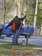 Andrew Bubb of Sheboygan works on an network cord that helps operate Making Spirits Bright Saturday November 14, 2015 at Evergreen Park in Sheboygan.