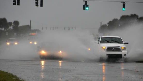 Friday morning brought heavy rains and gusty wins to the Space Coast. A1A by Patrick Air Force Base had some road flooding.