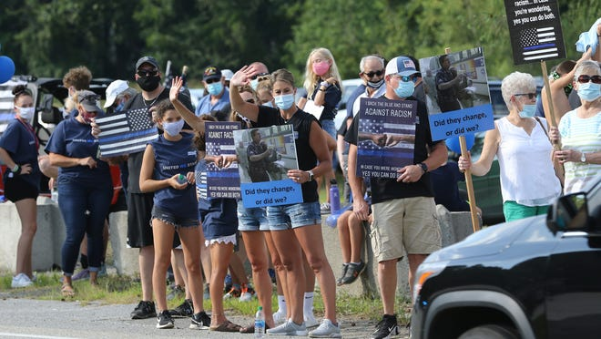 People line Boston Rd. in Westford to show their support for the police, Sunday night, Aug. 9, 2020.