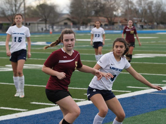 West Valley's Kailee Minnis, left, and Pleasant Valley's Tia Nevarez look to the ball during the Northern Section Division 1 quarterfinal soccer game Tuesday in Chico.