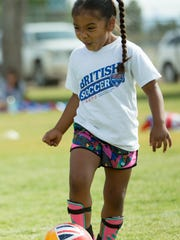 Lucia Aranda, 5, of Las Cruces, shows off some excitement while participating in the Challenger Sports British Soccer Camp on Friday, June 2, 2017, at the High Noon Soccer Complex.