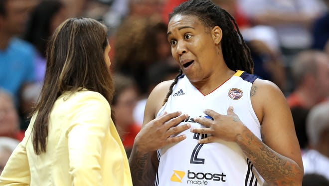 "Indiana Fever forward Erlana Larkins, shown talking to coach Stephanie White during a game, says the women's basketball program at North Carolina has been ""thrown under a bus."""