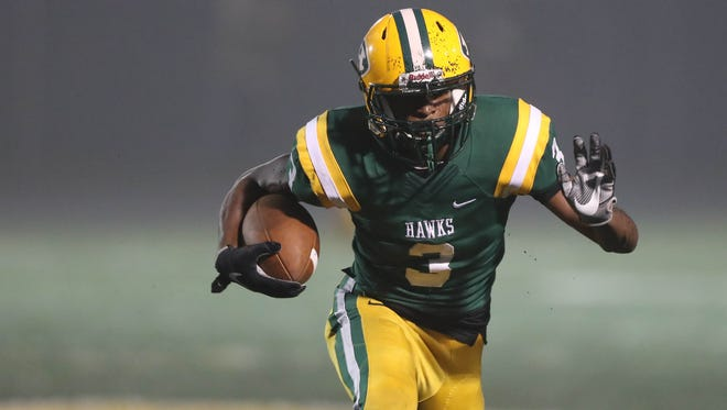 Farmington Hills Harrison's Roderick Heard runs the ball during the first half of Harrison's 17-14 win over Oak Park on Friday, Oct. 6, 2017, at Harrison.
