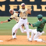 FIU player Julius Gaines (2) turns a double play during the championship game of the 2015 CUSA Baseball Tournament against UAB Sunday, May 24.