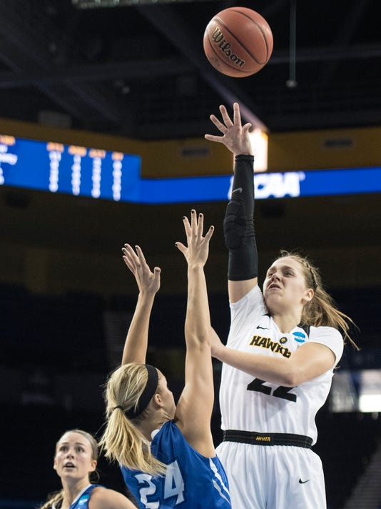 Iowa guard Kathleen Doyle, right, shoots a floater over Creighton guard Temi Carda during the first half of a first-round game in the NCAA women's college basketball tournament in Los Angeles, Saturday, March 17, 2018. (AP Photo/Kyusung Gong)