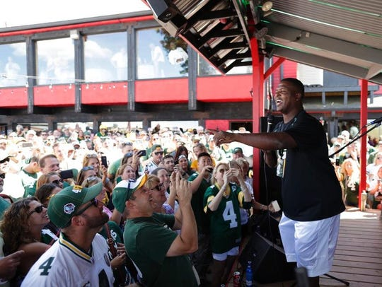 Former Packers player Leroy Butler talks to fans during