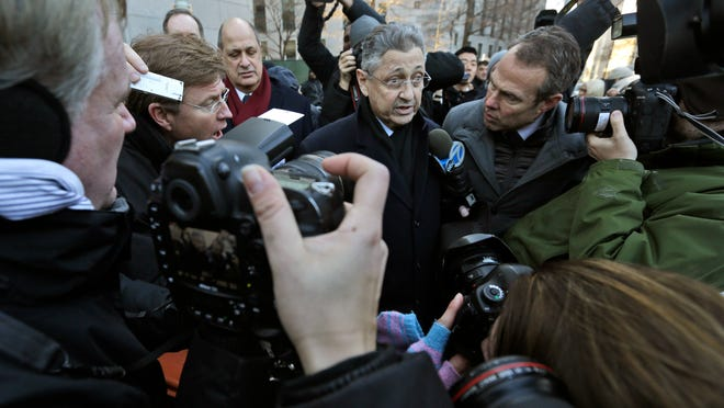 Assembly Speaker Sheldon Silver is surrounded by reporters as he leaves federal court Thursday.