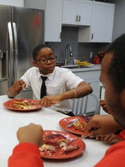 """""""It was real good, """" said Jauan Smith, 13, after sampling Rachael Ray's Pilgrim Monte Cristo sandwiches made during an on-air cooking demo in the gym's newly renovated kitchen. """"It's definitely something I would look forward to eating again. """"  During a second day of filming for her TV talk show, Rachael Ray treated kids and their families to a full Thanksgiving meal, presented a $25,000 donation from ConAgra Foods to the gym's founder and welcomed surprise guest / retired boxer Laila Ali at the Downtown Boxing Gym in Detroit, Michigan on November 16, 2015. (Brandy Baker/ The Detroit News )"""