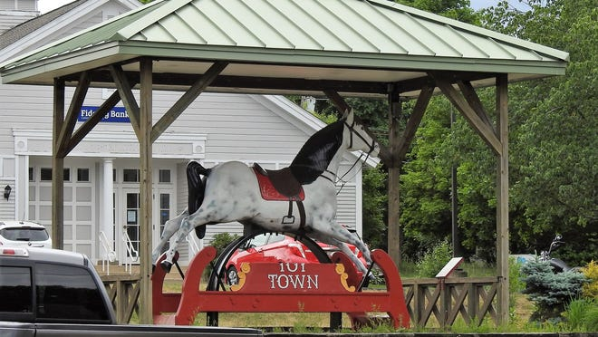 Clyde the Toy Town horse recently sustained damage when someone climbed on the sign to get into the saddle, breaking the sign in half. Residents Joe Ladeau and John Walker saw the damage and brought it home to fix it, but not before they contacted Town Hall to tell them what happened.