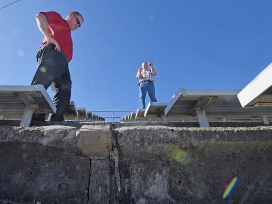 Shelby Schools Assistant Superintendent Paul Walker and Building Maintenance, Grounds and Safety Director Scott Harvey examine the deteriorating steps at the football stadium at W.W. Skiles Field in 2017.