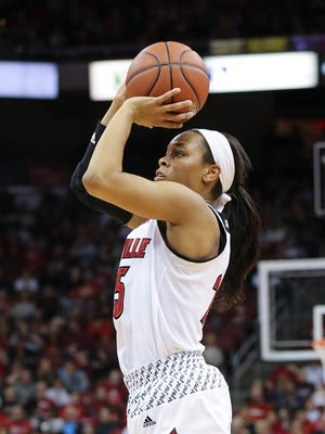 U of L's Asia Durr (25) shoots against FSU during their game at the KFC Yum! Center.  