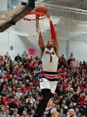 New Albany's Romeo Langford (1) dunks against Bedford North Lawrence during their game at New Albany High School.  It is Langford's last home game.  