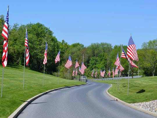 Donated burial flags greet visitors on the entrance