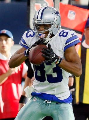 Dallas Cowboys wide receiver Terrance Williams (83) catches a pass but cannot stop the clock on the last play of the game against the New York Giants at AT&T Stadium.
