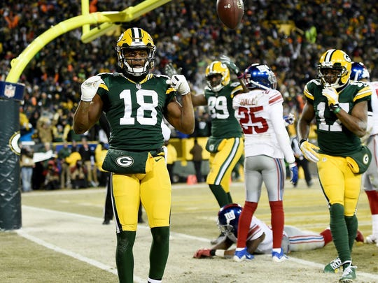 GREEN BAY, WI - JANUARY 08:  Randall Cobb #18 of the Green Bay Packers celebrates after scoring a touchdown in the second quarter during the NFC Wild Card game against the New York Giants at Lambeau Field on January 8, 2017 in Green Bay, Wisconsin.  (Photo by Stacy Revere/Getty Images)