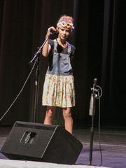 """GrooveKids performer Attie Pulsipher sings """"Little Toy Gun"""" in the Heritage Center Theater on Monday."""