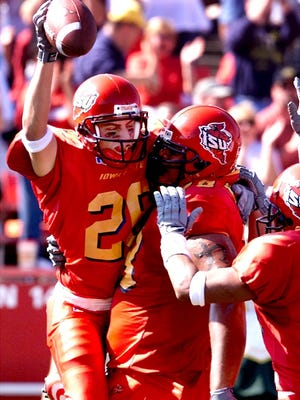 Iowa State University receiver Jack Whitver, left, celebrates his touchdown catch during a 2001 game against Baylor.