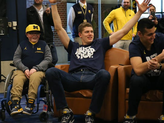 Michigan forward Moritz Wagner reacts after finding out Michigan will play Montana in the NCAA tournament Sunday.