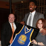 Jason Thompson with his Golden State Warriors jersey at a recent fundraiser in Philadelphia.