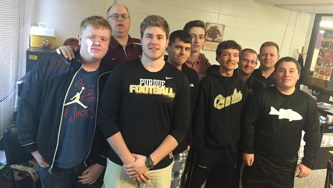 Meet the Delphi Community High School's Bracketology Club (from left): Jess Scowden, history teacher Brian Tonsoni, Jake Clousen, Daniel Jakes, Cole Rickels, Kain Myer, social studies teacher Dave Gilbert, math teacher Ty Schuller and Marcus Austin.