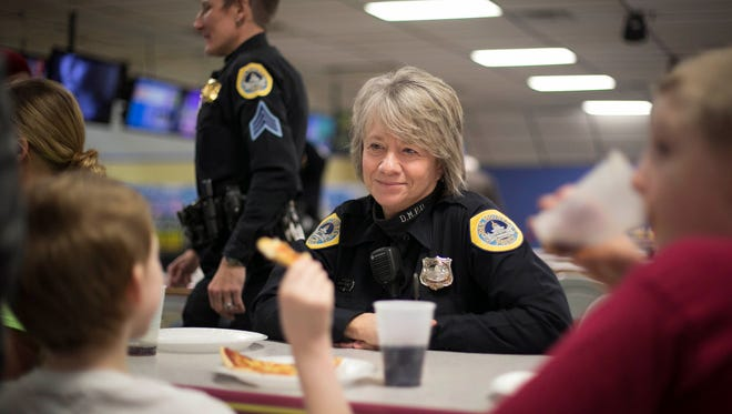 Des Moines police officer Kelly Drane does volunteer work with at-risk youth, such as during an outing at Air Lanes Bowling in Des Moines last week. In her police job, Drane works with the Mobile Crisis Team and helps train officers in dealing with people who suffer from mental illness.