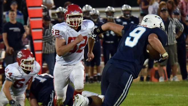 Sturgeon Bay's Trevor Jacobson drags down Manitowoc Roncalli's Mason Hrudka during a nonconference game last year.