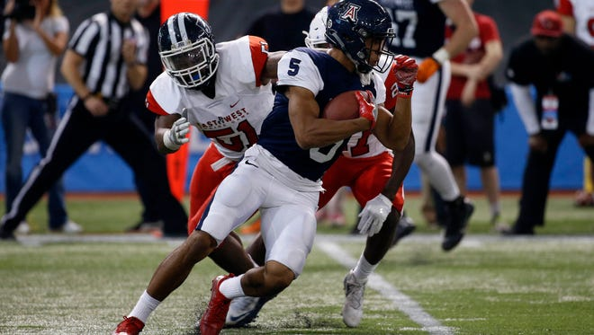 West Team wideout Trey Griffey (5) runs with the ball during the second half of the East-West Shrine Game at Tropicana Field on Jan. 21.