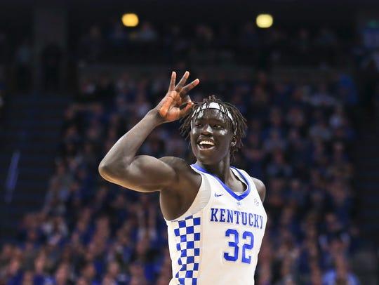 Kentucky's Gabriel Wenyen signals his three-point shot