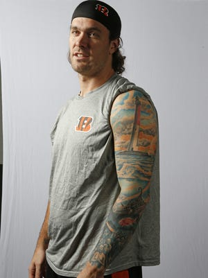 Cincinnati Bengals long snapper Clark Harris (46) shows the tattoo on his left arm, featuring beach scenes, and a lighthouse from his home town of Long Beach Island, New Jersey.