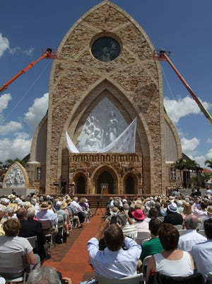 FILE: A good sized crowd witnessed the Unveiling and Dedication of the Annunciation of Ave Maria  Friday March 25,2011 at Ave Maria University in Immokalee. Here the sculpture is being unveiled.
