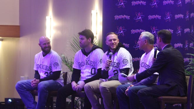 The Colorado Rockies' Mike Dunn, left, Adam Ottavino, Trevor Story and Bud Black speak during a Q&A session with fans on Friday at the Albuquerque Convention Center.