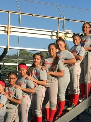 The Border Pest Control Cardinals ran an unblemished 12-0 during the regular season in Deming Little League softball in the Major Division (ages 11-12). The undefeated season was celebrated by players, coach and Parents at the conclusion of the team's run. The players from bottom to top: Bianca Valverde, Mariah Pacheco, Amanda Martinez, Alyssa Olivas, Daisy Munoz, Kianna Ramos, Isis Olivas, Jasmine Lopez, Briana Flores, and Jenae Jasso. Not pictured is Minnie Ramirez. Coaches are Cedric Jasso and Mike Valverde.