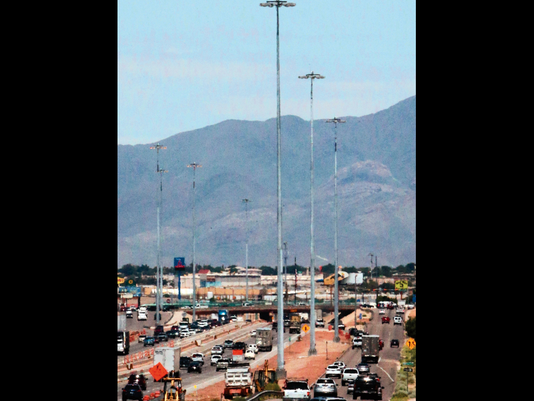 Newly installed high mast lighting is seen along both sides of I-10 just East of Lee Treviño Tuesday.