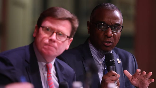 Charles Robert Bone with Transit for Nashville, left, and jeff obafemi carr with No Tax for Tracks, participate in The Tennessean's transit debate held Tuesday April 10, 2018 at the Nashville Public Library.
