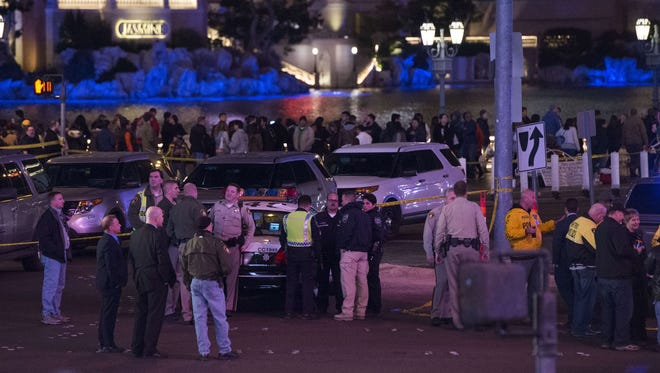 Police and local officials investigate the scene on the Las Vegas Strip on Dec. 20, 2015.